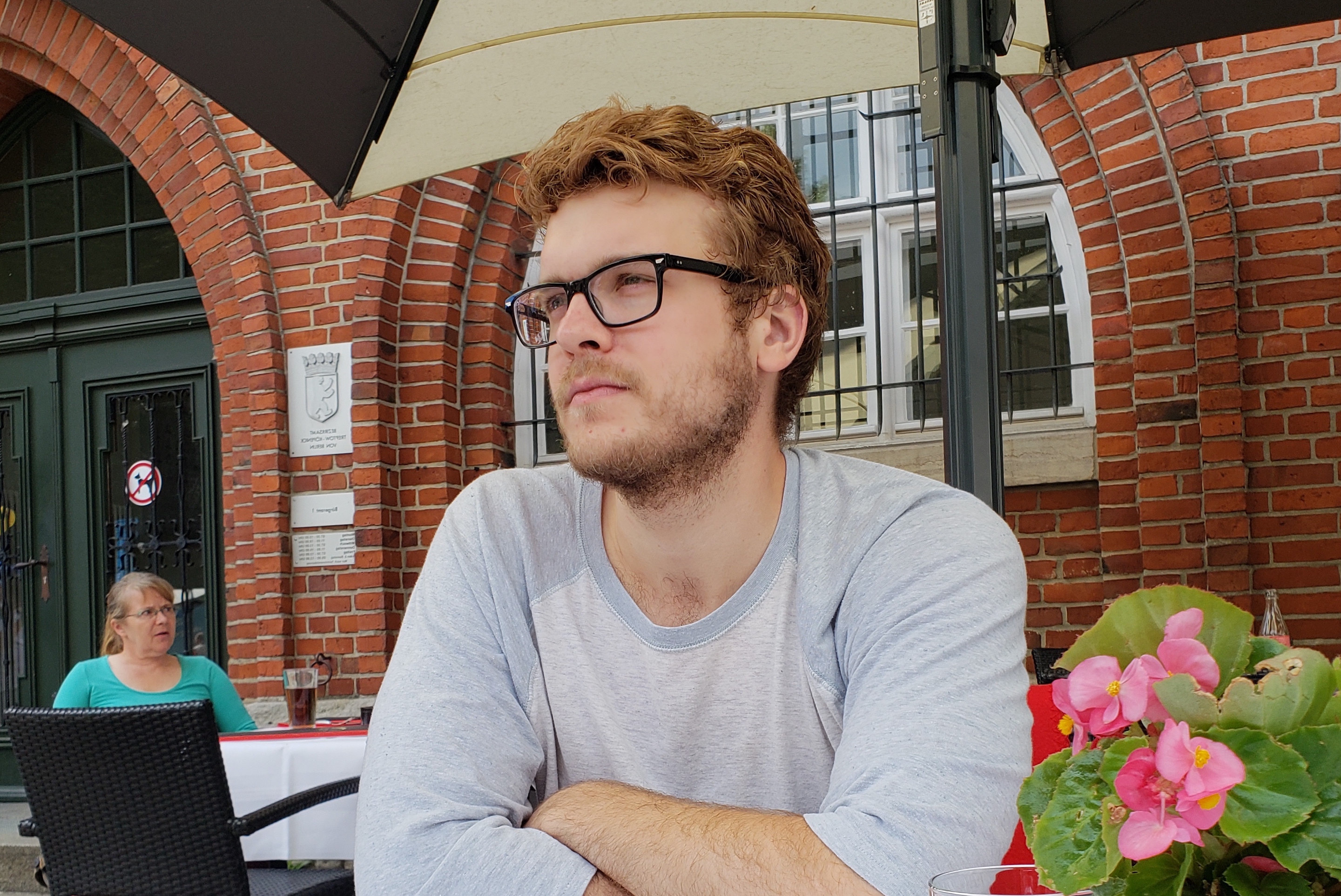 Grad student sits at an outdoor cafe